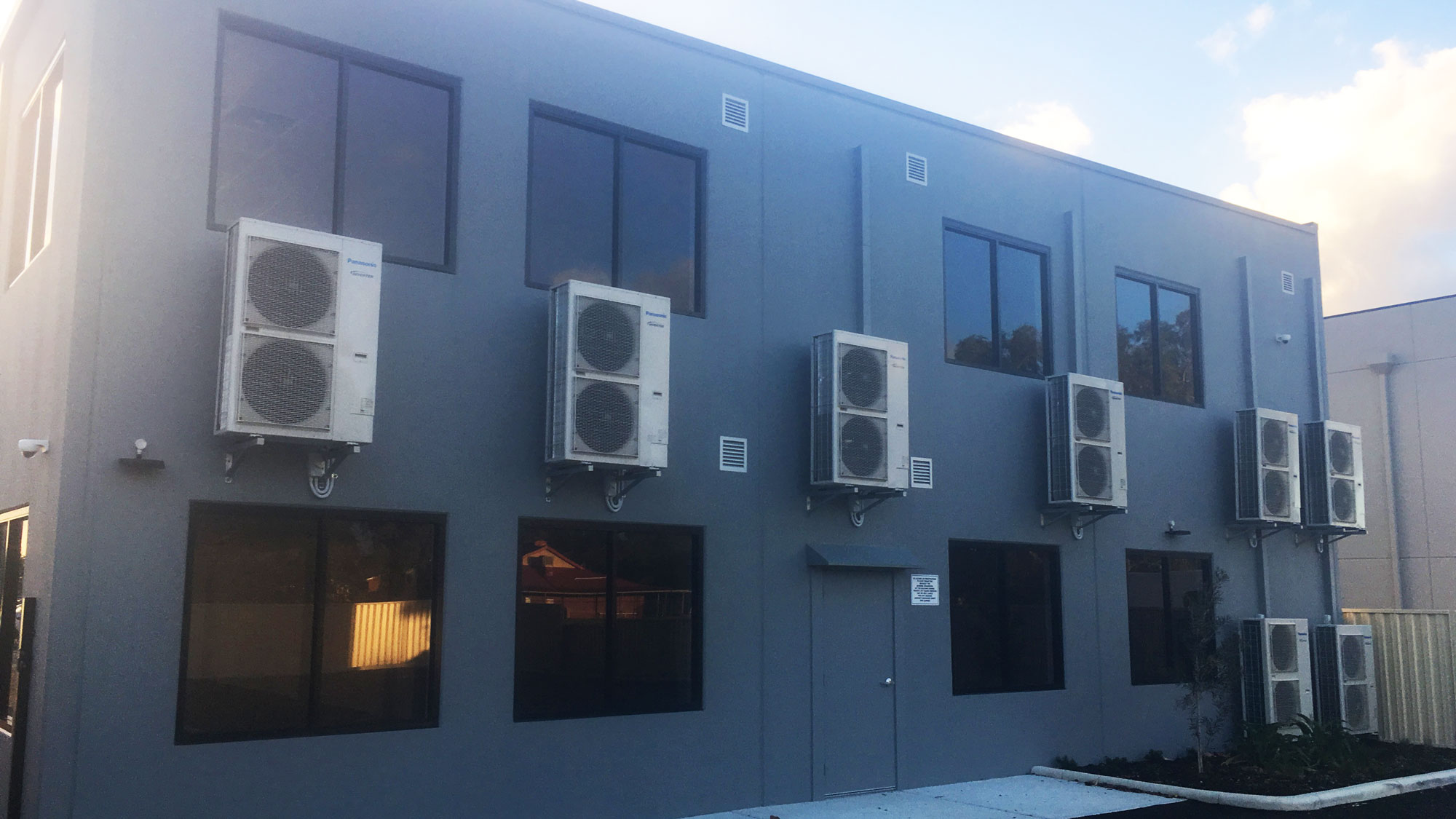 air conditioners on the side of a building