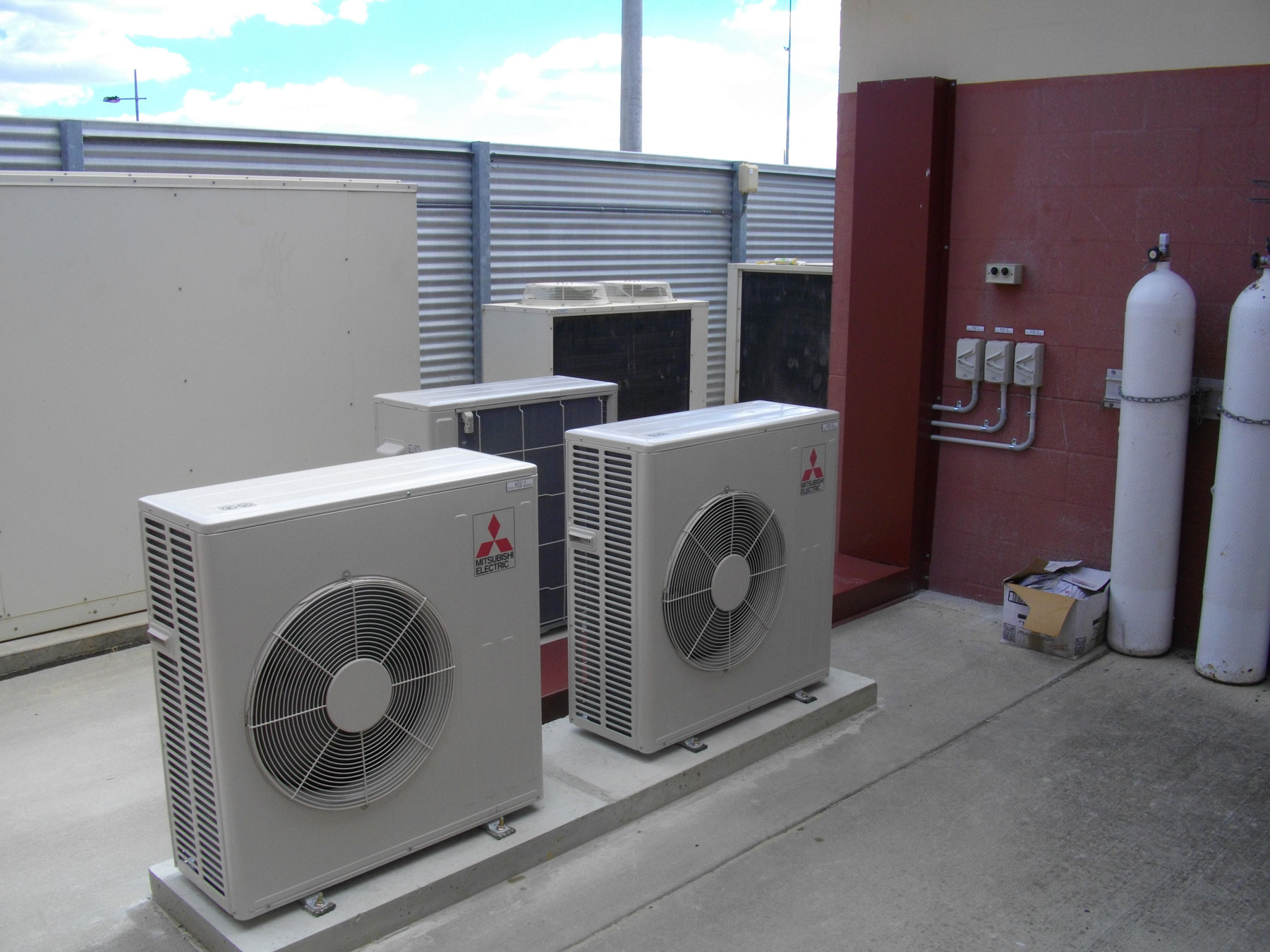 air conditioning units sitting side by side