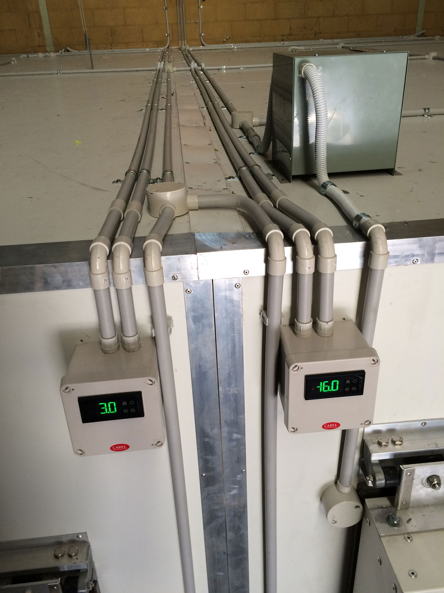 commercial refrigeration unit with temperature gauges