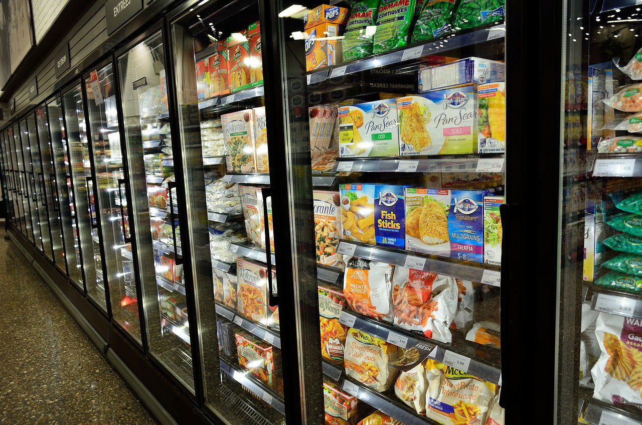 Supermarket fridges full of food