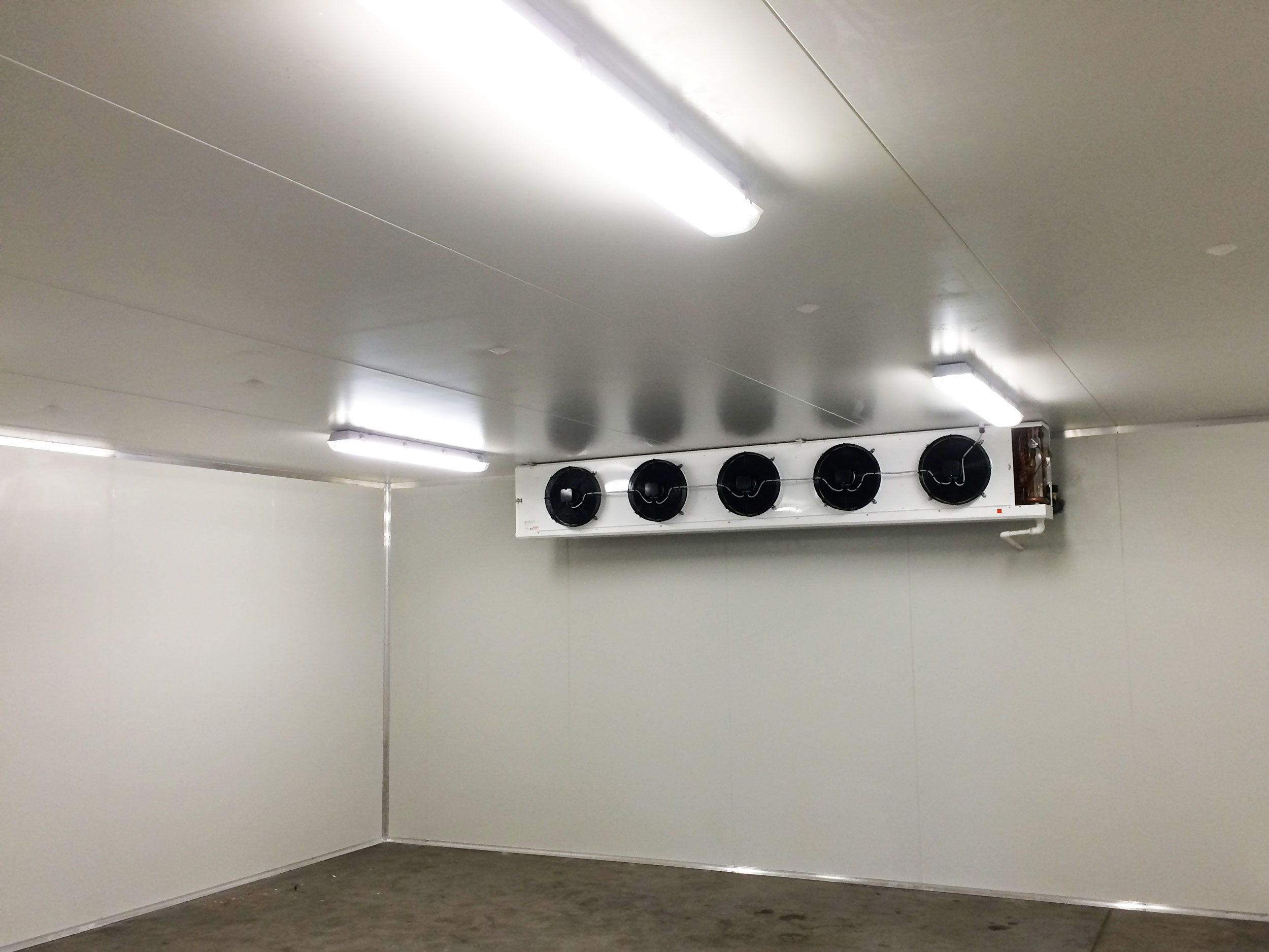 inside a commercial air conditioning unit with fans