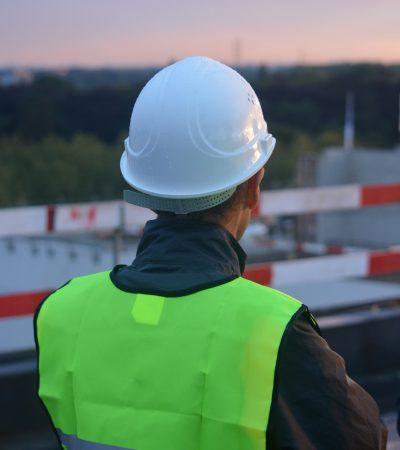 Man in safety helmet and high vis vest